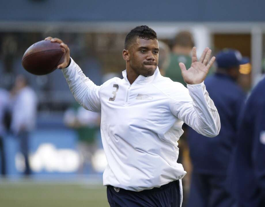 Seattle Seahawks quarterback Russell Wilson passes during warm-ups before an NFL football game against the Green Bay Packers, Thursday, Sept. 4, 2014, in Seattle. (AP Photo/Elaine Thompson) Photo: Elaine Thompson, AP
