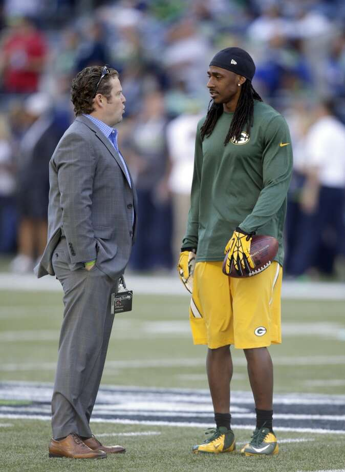 Green Bay Packers cornerback Demetri Goodson, right, talks with Seattle Seahawks general manager John Schneider, left, on the field before an NFL football game between the Seattle Seahawks and the Green Bay Packers, Thursday, Sept. 4, 2014, in Seattle. (AP Photo/Stephen Brashear) Photo: Stephen Brashear, AP