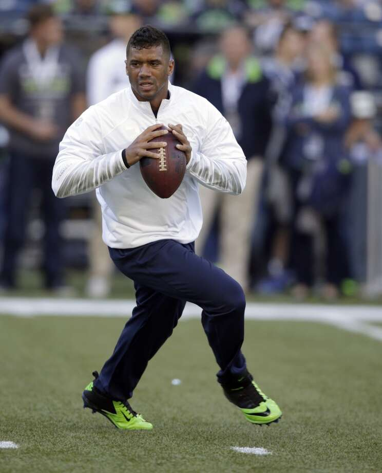 Seattle Seahawks quarterback Russell Wilson warms-up on the field before an NFL football game against the Green Bay Packers, Thursday, Sept. 4, 2014, in Seattle. (AP Photo/Stephen Brashear) Photo: Stephen Brashear, AP