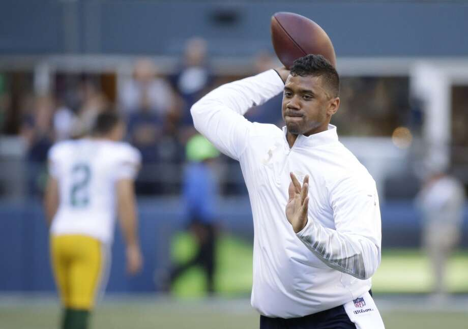 Seattle Seahawks quarterback Russell Wilson passes during warm-ups for an NFL football game against the Green Bay Packers, Thursday, Sept. 4, 2014, in Seattle. (AP Photo/Elaine Thompson) Photo: Elaine Thompson, AP