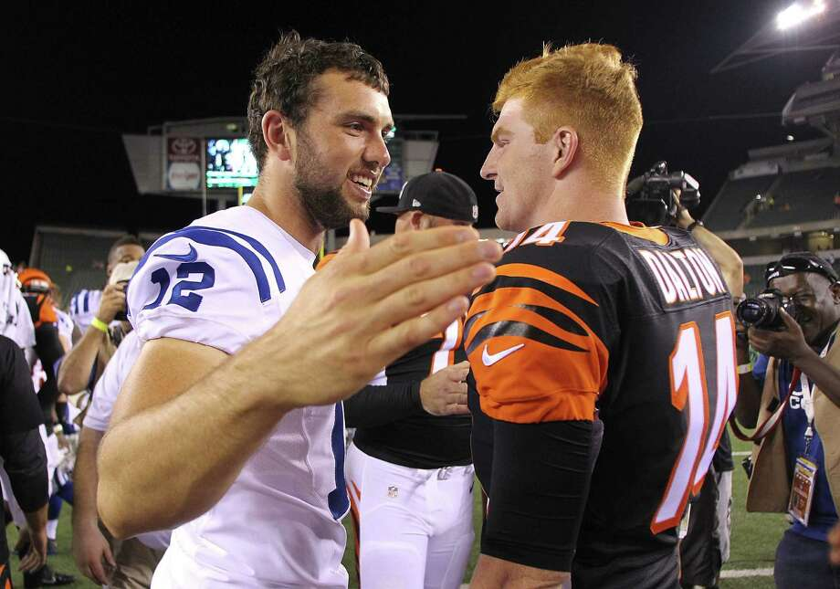 CINCINNATI, OH - AUGUST 28:  Andrew Luck #12 of the Indianapolis Colts and Andy Dalton #14 of the Cincinnati Bengals talk after the game at Paul Brown Stadium on August 28, 2014 in Cincinnati, Ohio. Cincinnati defeated Indianapolis 35-7. Photo: John Grieshop, Getty Images / 2014 Getty Images