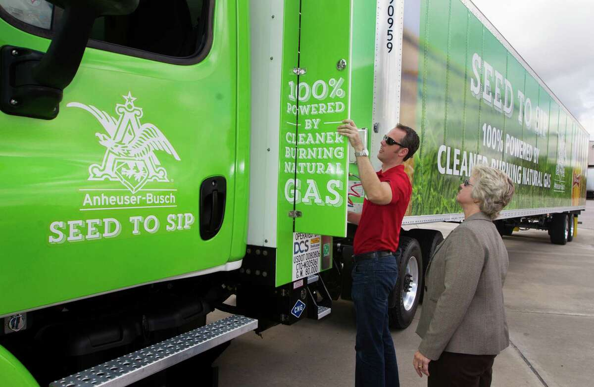 Chris Nordh shows Mayor Annise Parker a truck powered by compressed natural gas. A grant is helping to fund the Anheuser-Busch conversion.
