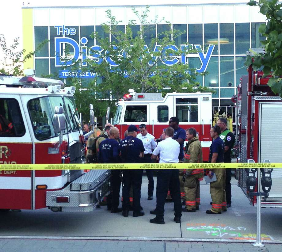 Firefighters confer outside the Nevada Discovery Museum in Reno in the wake of a flash fire that injured 13 people. Photo: Scott Sonner / Associated Press / AP