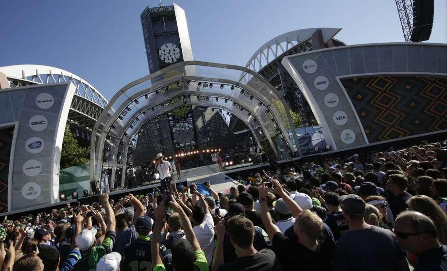 Pop singer Pharrell Williams performs at a concert outside CenturyLink Field before an NFL football game between the Seattle Seahawks and the Green Bay Packers, Thursday, Sept. 4, 2014, in Seattle. (AP Photo/Scott Eklund) Photo: Scott Eklund, AP