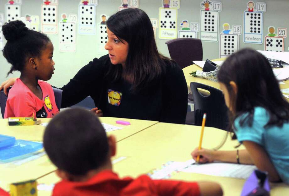 First year teacher Christina Hannah, center, works with student Karma Jernigan on their first day of school at Eagle Point Elementary on Thursday Sept. 4, 2014 in Albany, N.Y.  (Michael P. Farrell/Times Union) Photo: Michael P. Farrell / 00028468A