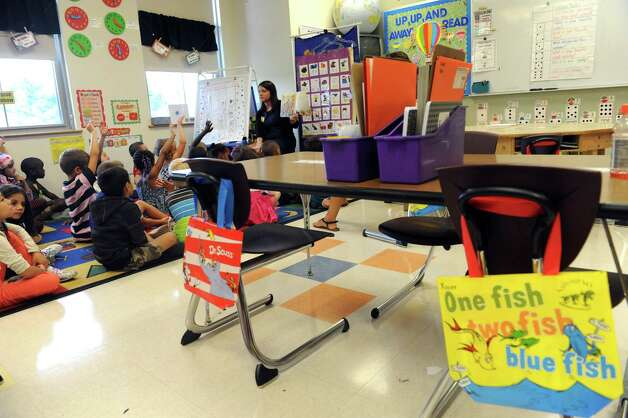 First year teacher Christina Hannah reads the book, First Day Jitters, to her first grade class on their first day of school at Eagle Point Elementary on Thursday Sept. 4, 2014 in Albany, N.Y.  (Michael P. Farrell/Times Union) Photo: Michael P. Farrell / 00028468A
