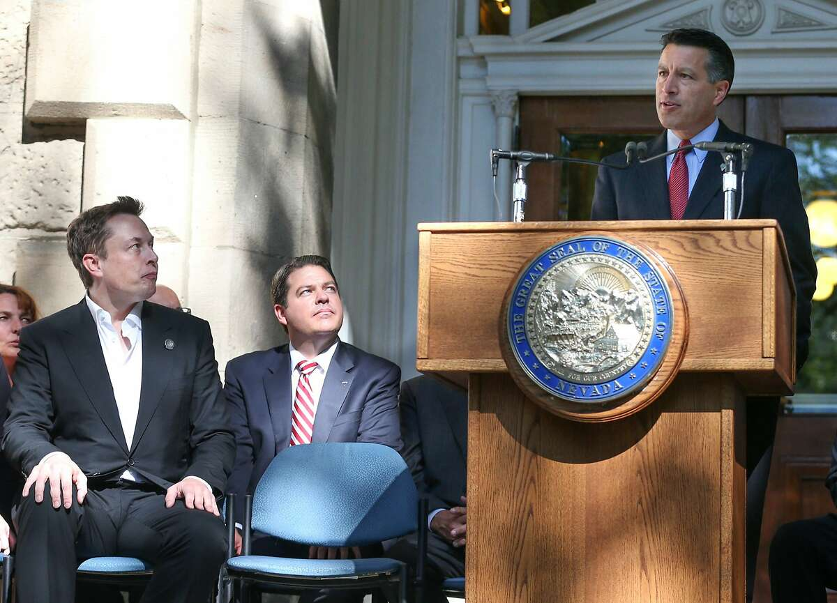 Nevada Gov. Brian Sandoval announces that Nevada was chosen as the new site for a $5 billion Tesla Motors car battery factory, during a press conference at the Capitol in Carson City, Nev., on Thursday, Sept. 4, 2014. Tesla CEO Elon Musk, left, also spoke about the gigafactory his company will build east of Reno, bringing an estimated 6,500 jobs. (AP Photo/Cathleen Allison)
