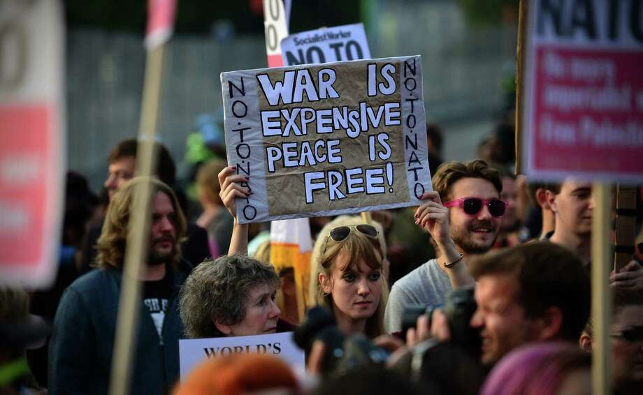 Demonstrators take part in a protest against the NATO summit outside Cardiff Castle in south Wales. Photo: Carl Court / Getty Images / AFP