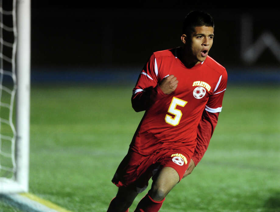 Stratford's Jairo Barrera runs away from the goal after scoring against Bunnell, during boys high school soccer action in Stratford, Conn. on Wednesday October 23, 2013. Photo: Christian Abraham / Connecticut Post