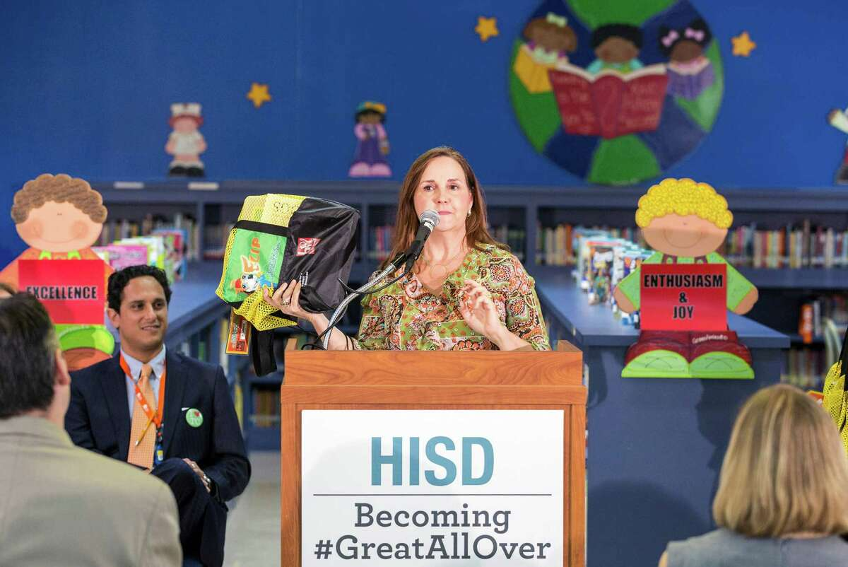 """Cindy Puryear, the district's director of literacy, leads Thursday's news conference at Garcia Elementary announcing """"Read Houston Read,"""" a program to pair 1,500 volunteers with students for weekly readings."""