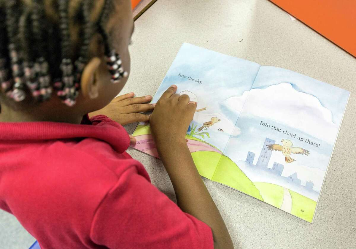 Sarah Miles, 6, is learning to read in Brittany White's first-grade class at Garcia Elementary.