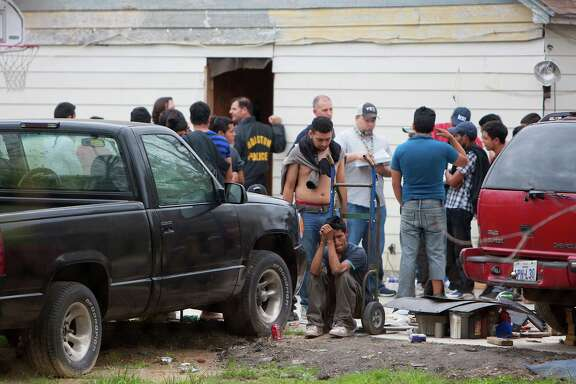 More than 100 people were found March 19 inside a house at 14711 Almeda School Road.