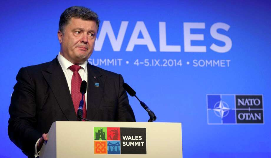 Ukrainian President Petro Poroshenko speaks during a media conference during a NATO summit at the Celtic Manor Resort in Newport, Wales on Thursday, Sept. 4, 2014. In a two-day summit leaders will discuss, among other issues, the situation in Ukraine and Afghanistan. (AP Photo/Virginia Mayo) ORG XMIT: VLM141 Photo: Virginia Mayo / AP