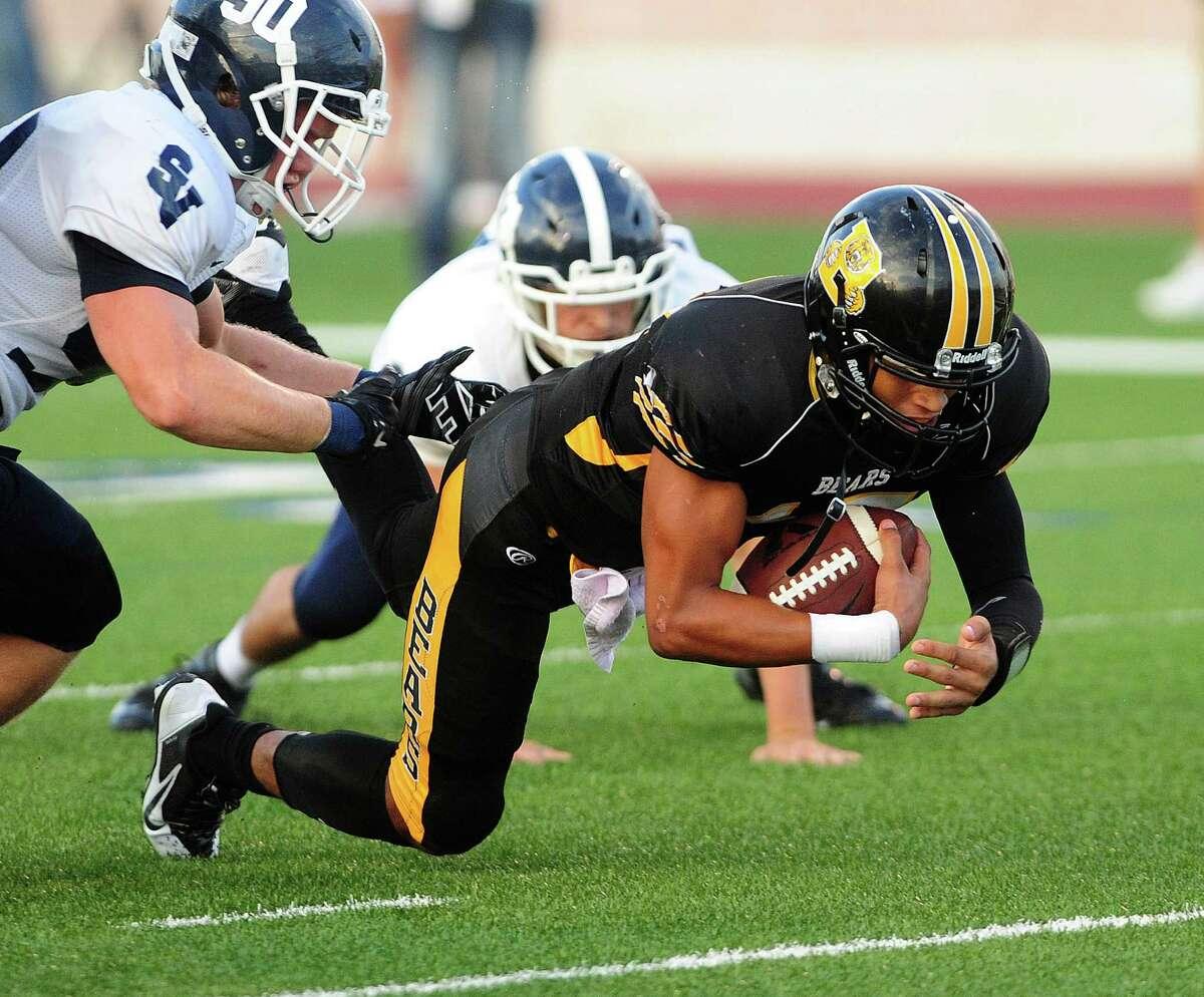 Brennan quarterback Da'Shawn Key scores a first-half touchdown against Smithson Valley during high school football action at Farris Stadium on Thursday, Sept. 4, 2014.