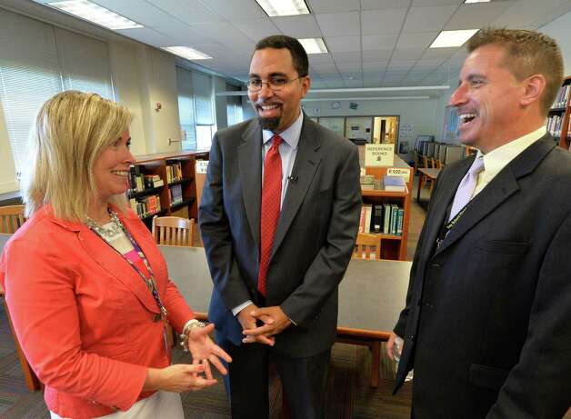 NYS Commissioner of Education John B. King Jr., center speaks with Donna Watson, assistant superintendent for curriculum, left and Troy High School Prinicpal Joe Mariano during as he visits the inaugural class of the Troy Riverfront  P-tech program Thursday afternoon  Sept. 4, 2014, at Troy High School in Troy, N.Y.   (Skip Dickstein/Times Union) Photo: SKIP DICKSTEIN / 00028475A