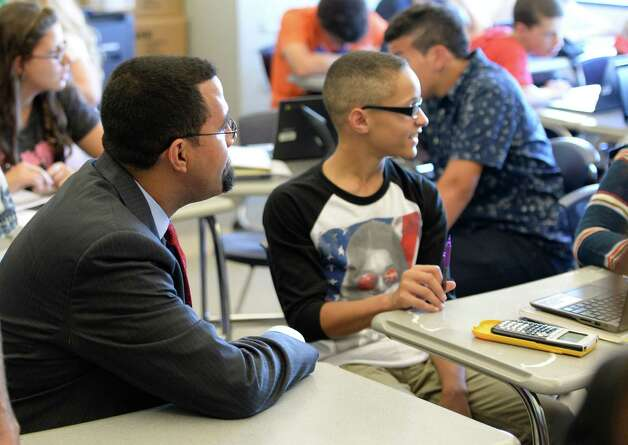 NYS Commissioner of Education John B. King Jr., left,  visits the inaugural class of the Troy Riverfront  P-tech program Thursday afternoon  Sept. 4, 2014, at Troy High School in Troy, N.Y.   (Skip Dickstein/Times Union) Photo: SKIP DICKSTEIN / 00028475A