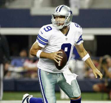 Tony Romo played through the pain of a ruptured disk to help the Cowboys win a critical game late last year, but the team still fell short of the playoffs for the fourth straight season. Photo: Ray Carlin / Fort Worth Star-Telegram / Fort Worth Star-Telegram
