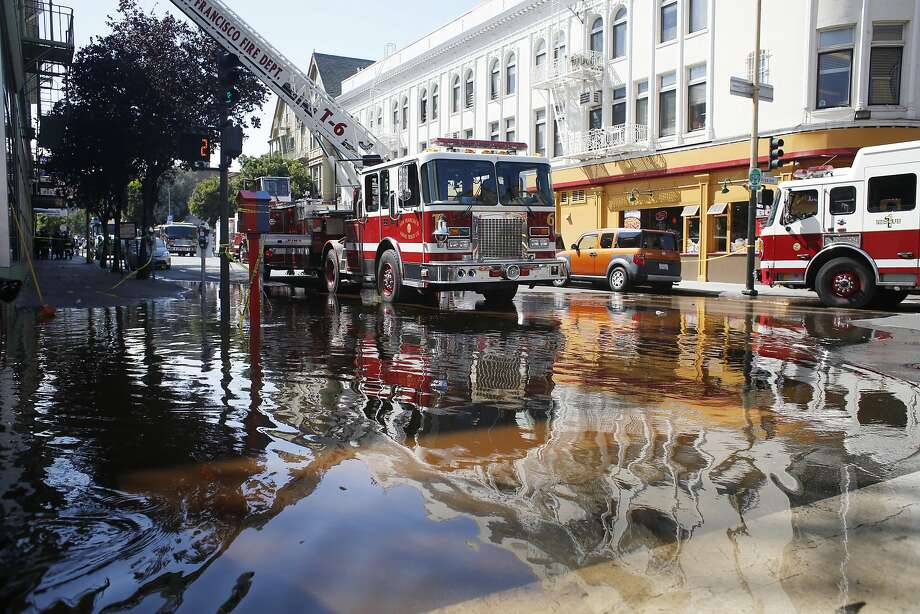 22nd Street is floods as SFFD works to put out a five alarm fire on the West side of Mission Street between 22nd and 23rd streets in San Francisco, Calif. Photo: Mike Kepka