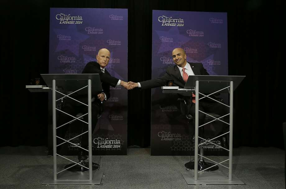 Gov. Jerry Brown, left, shakes hands with Republican challenger Neel Kashkari as they pose for photographs before a gubernatorial debate in Sacramento, Calif., Thursday, Sept. 4, 2014. Thursday's debate is likely to be the only one of the general election. (AP Photo/Rich Pedroncelli, Pool) Photo: Rich Pedroncelli, Associated Press