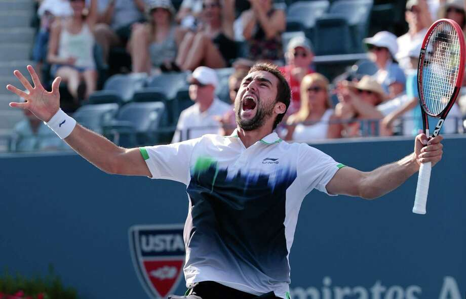 Marin Cilic, of Croatia, reacts after defeating Tomas Berdych, of the Czech Republic, during the quarterfinals of the 2014 U.S. Open tennis tournament, Thursday, Sept. 4, 2014, in New York. (AP Photo/Julio Cortez) ORG XMIT: USO148 Photo: Julio Cortez / AP