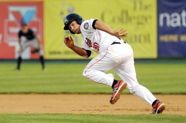 ValleyCats' Nick Tanielu, right, takes off for second during their baseball game against the Tigers on Thursday, Sept. 4, 2014, at Bruno Stadium in Troy, N.Y. (Cindy Schultz / Times Union) Photo: Cindy Schultz / 00028411A