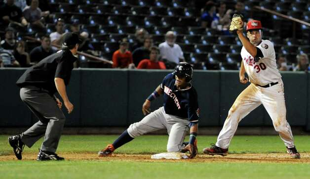 ValleyCats' Nick Tanielu, right,  tags out Tigers' Franklin Navarro during their baseball game on Thursday, Sept. 4, 2014, at Bruno Stadium in Troy, N.Y. (Cindy Schultz / Times Union) Photo: Cindy Schultz / 00028411A
