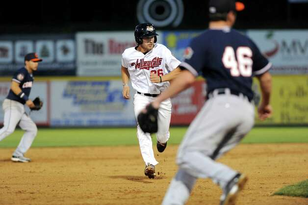 ValleyCats' Jamie Ritchie, center, sprints to third during their baseball game against the Tigers on Thursday, Sept. 4, 2014, at Bruno Stadium in Troy, N.Y. (Cindy Schultz / Times Union) Photo: Cindy Schultz / 00028411A