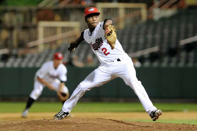 ValleyCats' Angel Heredia winds up the pitch during their baseball game against the Tigers on Thursday, Sept. 4, 2014, at Bruno Stadium in Troy, N.Y. (Cindy Schultz / Times Union) Photo: Cindy Schultz / 00028411A