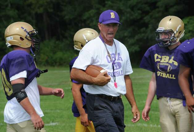 CBA football coach Joe Burke runs through drills with his team during practice on Wednesday, Aug. 27, 2014 in Colonie, N.Y.  (Lori Van Buren / Times Union) Photo: Lori Van Buren / 00028339A