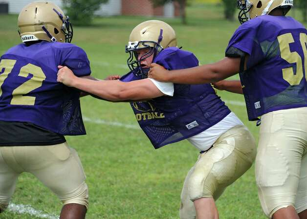 CBA lineman Patrick Pastore, center, runs through drills with his teammates during practice on Wednesday, Aug. 27, 2014 in Colonie, N.Y.  (Lori Van Buren / Times Union) Photo: Lori Van Buren / 00028339A