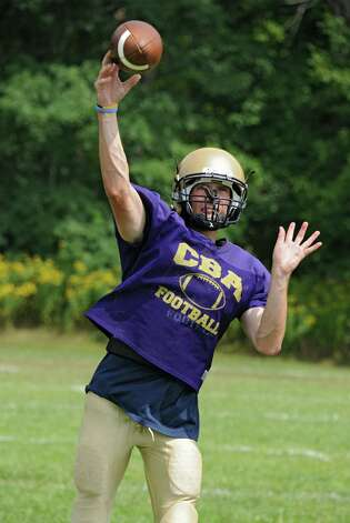 CBA quarterback Joe Kolbe throws the ball during practice on Wednesday, Aug. 27, 2014 in Colonie, N.Y.  (Lori Van Buren / Times Union) Photo: Lori Van Buren / 00028339A
