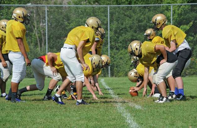 The Cohoes football team practices on a practice field on Wednesday, Sept. 3, 2014 in Cohoes, N.Y.  Cohoes will not playing a home game until Week 7 because of drainage problems. (Lori Van Buren / Times Union) Photo: Lori Van Buren / 00028442A