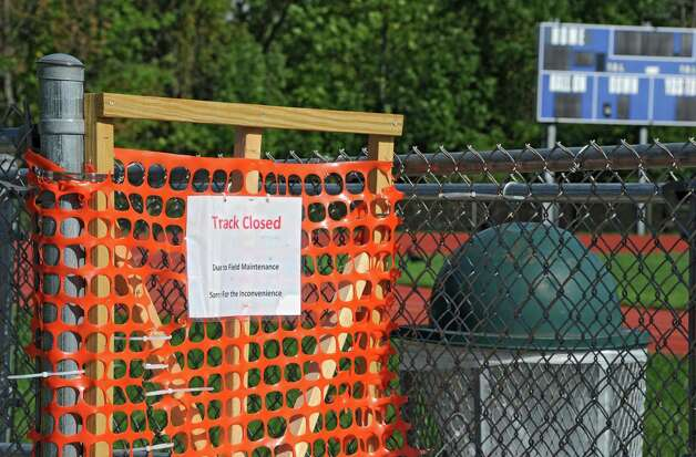 A sign is posted on one of the entrances to the Cohoes football field on Wednesday, Sept. 3, 2014 in Cohoes, N.Y.  Cohoes will not playing a home game until Week 7 because of drainage problems on this field. (Lori Van Buren / Times Union) Photo: Lori Van Buren / 00028442A