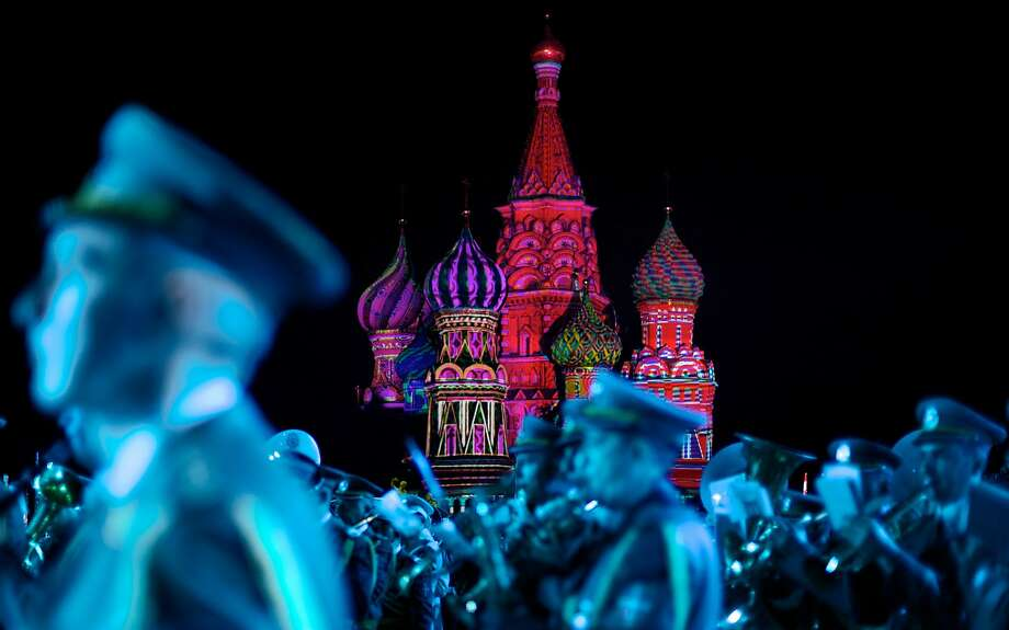 "AP10ThingsToSee- St. Basil Cathedral is lit using show lights as Serbian Nish military band members perform during the rehearsal of ""Spasskaya Tower"" International Military Orchestra Music Festival at the Red Square in Moscow, Russia, Friday, Aug. 29, 2014. (AP Photo/Ivan Sekretarev) Photo: Ivan Sekretarev, Associated Press"