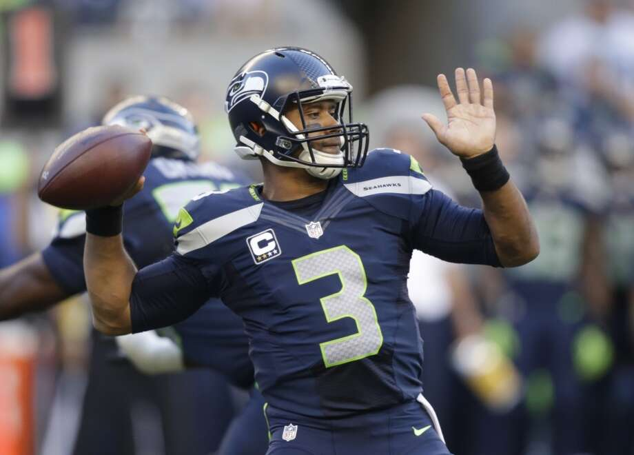 Seattle Seahawks quarterback Russell Wilson winds up to pass against the Green Bay Packers in the first half of an NFL football game, Thursday, Sept. 4, 2014, in Seattle. (AP Photo/Stephen Brashear) Photo: Stephen Brashear, AP