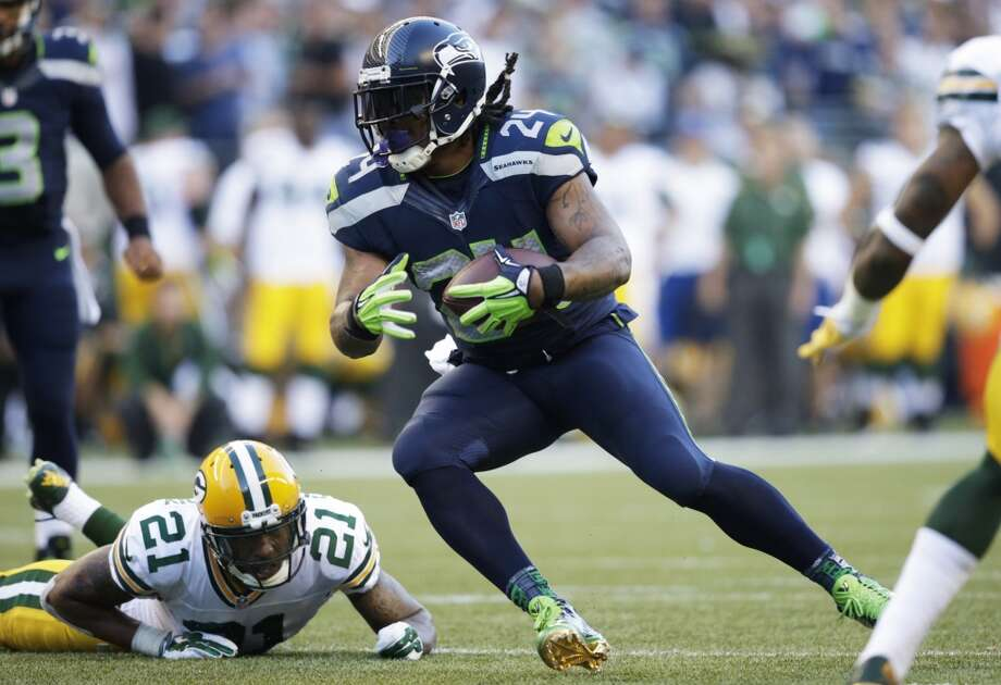Seattle Seahawks running back Marshawn Lynch runs the ball past free safety Ha Ha Clinton-Dix (21) in the first half of an NFL football game, Thursday, Sept. 4, 2014, in Seattle. (AP Photo/Scott Eklund) Photo: Scott Eklund, AP