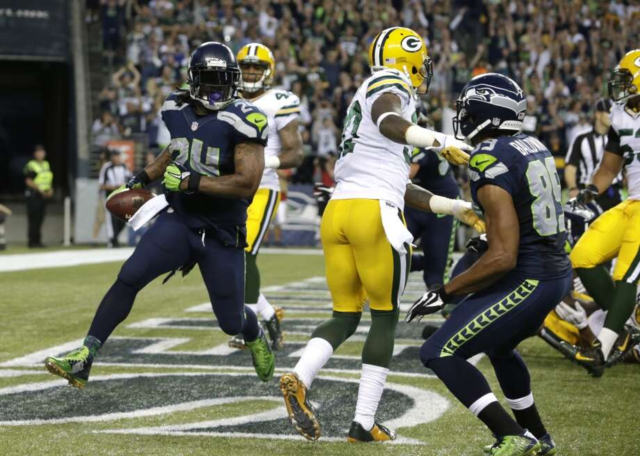 Seattle Seahawks running back Marshawn Lynch, left, looks back after a touchdown against the Green Bay Packers in the second half of an NFL football game, Thursday, Sept. 4, 2014, in Seattle. (AP Photo/Scott Eklund) Photo: Scott Eklund, AP