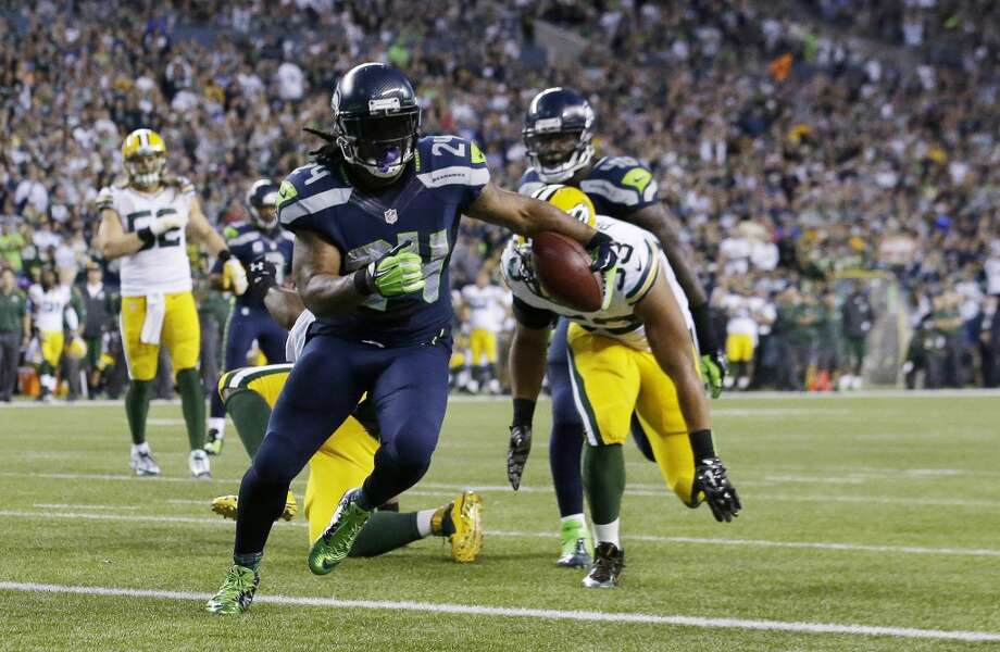 Seattle Seahawks running back Marshawn Lynch scores a touchdown against the Green Bay Packers in the second half of an NFL football game, Thursday, Sept. 4, 2014, in Seattle. (AP Photo/Elaine Thompson) Photo: Elaine Thompson, AP