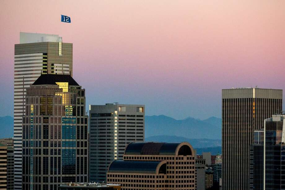 A tiny 12th Man flag flaps over downtown Seattle in support of the home team during the Seattle Seahawks season opener game against the Green Bay Packers Thursday, September 4, 2014, in Seattle, Washington. The Seahawks won the game 36-16. (Jordan Stead, seattlepi.com) Photo: JORDAN STEAD, SEATTLEPI.COM