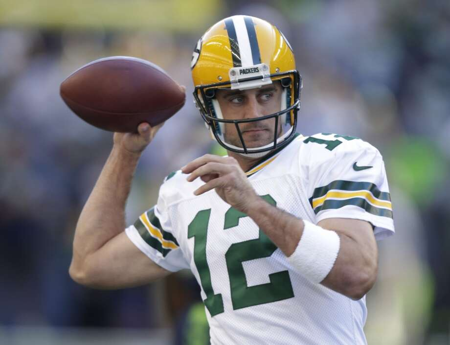 Green Bay Packers quarterback Aaron Rodgers warms up for the Packers' NFL football game against the Seattle Seahawks, Thursday, Sept. 4, 2014, in Seattle. (AP Photo/Stephen Brashear) Photo: Stephen Brashear, AP