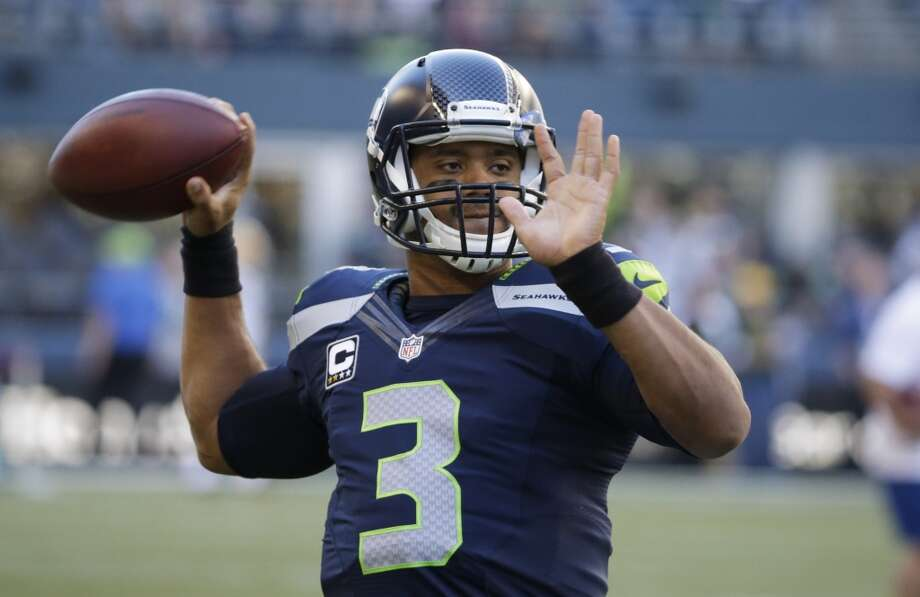Seattle Seahawks quarterback Russell Wilson warms up for the Seahawks' NFL football game against the Green Bay Packers, Thursday, Sept. 4, 2014, in Seattle. (AP Photo/Elaine Thompson) Photo: Elaine Thompson, AP