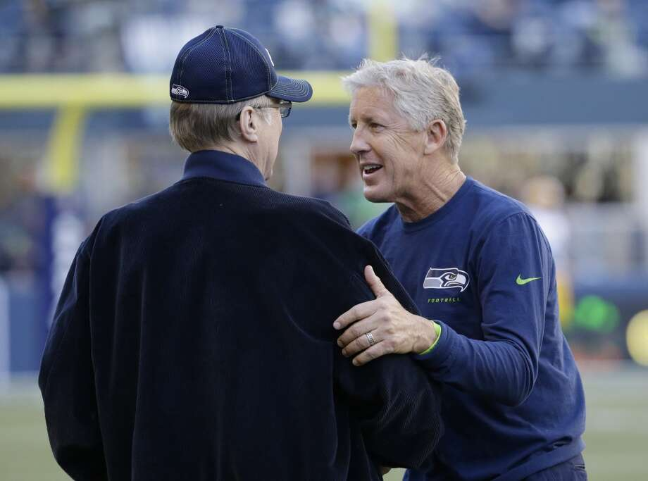 Seattle Seahawks head coach Pete Carroll, right, talks with Seahawks owner Paul Allen, left, before an NFL football game between the Seattle Seahawks and the Green Bay Packers, Thursday, Sept. 4, 2014, in Seattle. (AP Photo/Elaine Thompson) Photo: Elaine Thompson, AP