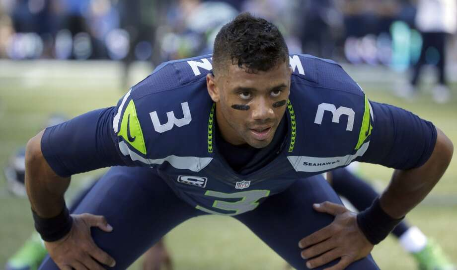 Seattle Seahawks quarterback Russell Wilson stretches before an NFL football game against the Green Bay Packers, Thursday, Sept. 4, 2014, in Seattle. (AP Photo/Elaine Thompson) Photo: Elaine Thompson, AP