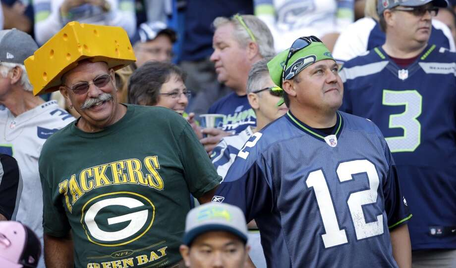 Green Bay Packers and Seattle Seahawks fans stand near each other in the stands before an NFL football game, Thursday, Sept. 4, 2014, in Seattle. (AP Photo/Elaine Thompson) Photo: Elaine Thompson, AP