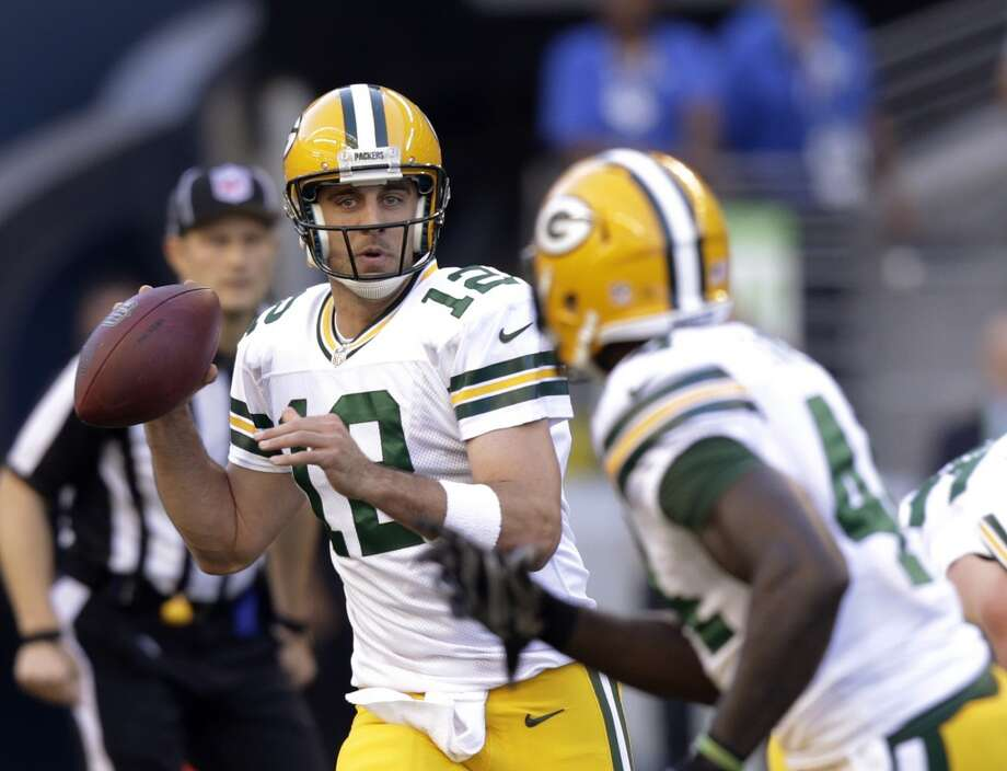 Green Bay Packers quarterback Aaron Rodgers looks to pass against the Seattle Seahawks in the first half of an NFL football game, Thursday, Sept. 4, 2014, in Seattle. (AP Photo/Stephen Brashear) Photo: Stephen Brashear, AP