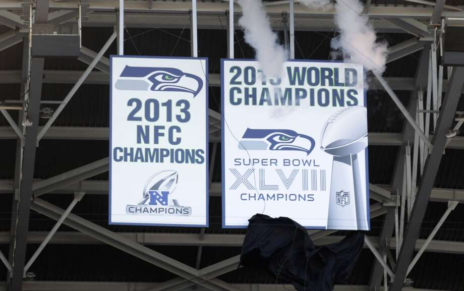 The Seattle Seahawks Super Bowl championship banner is unveiled before an NFL football game between the Seahawks and the Green Bay Packers, Thursday, Sept. 4, 2014, in Seattle. (AP Photo/Stephen Brashear) Photo: Stephen Brashear, AP