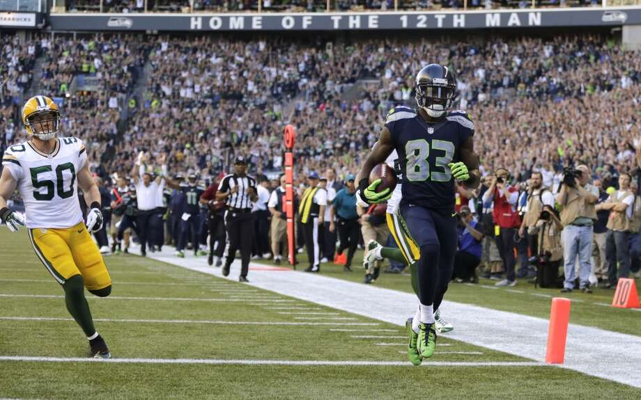 Seattle Seahawks wide receiver Ricardo Lockette (83) runs in for a touchdown against the Green Bay Packers in the first half of an NFL football game, Thursday, Sept. 4, 2014, in Seattle. (AP Photo/Scott Eklund) Photo: Scott Eklund, AP