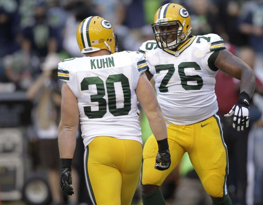 Green Bay Packers fullback John Kuhn (30) celebrates his touchdown against the Seattle Seahawks with Mike Daniels (76) in the first half of an NFL football game, Thursday, Sept. 4, 2014, in Seattle. (AP Photo/Stephen Brashear) Photo: Stephen Brashear, AP