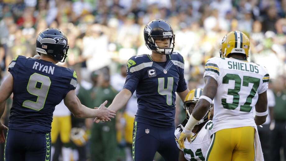 Seattle Seahawks kicker Steven Hauschka (4) slaps hands with holder Jon Ryan in front of Green Bay Packers' Sam Shields (37) after Hauschka kicked a field goal in the first half of an NFL football game, Thursday, Sept. 4, 2014, in Seattle. (AP Photo/Elaine Thompson) Photo: Elaine Thompson, AP
