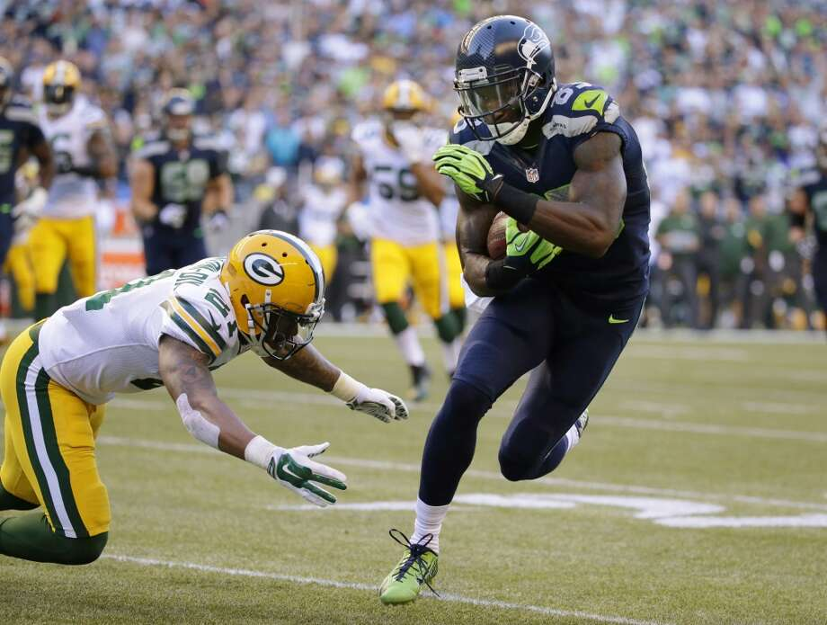 Seattle Seahawks wide receiver Ricardo Lockette avoids Green Bay Packers free safety Ha Ha Clinton-Dix, left, to score a touchdown in the first half of an NFL football game, Thursday, Sept. 4, 2014, in Seattle. (AP Photo/Elaine Thompson) Photo: Elaine Thompson, AP
